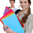 Students with folders — Stock Photo