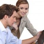 Couple using a laptop — Stock Photo