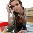 Stock Photo: Female student studying hard