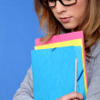 Young student carrying files — Stock Photo #10390825