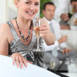 Blond woman with glass of champagne — Stock Photo