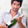 Man with bottle of champagne — Stock Photo #10391638