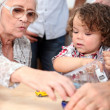 Grandmother playing with grandson - Stock Photo