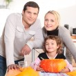 Parents with a child and pumpkin — Stock Photo
