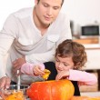 Father with daughter emptying pumpkin — Stock Photo