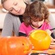 Woman and girl with pumpkins — Stock Photo
