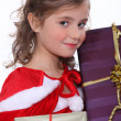 Pretty girl holding her Christmas presents — Stok fotoğraf #10391814