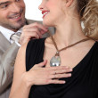 Man attaching his wife's necklace — Stock Photo #10392184