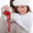 Stock Photo: Young couple hugging with a wrapped present