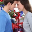 Couple in front of a Christmas tree — Stock Photo #10392504