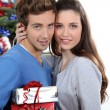 Young couple at Christmas — Stock Photo #10392553