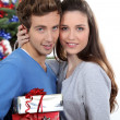 Foto Stock: Young couple at Christmas