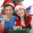 Young couple at Christmas — Stock fotografie