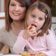 Mother and daughter eating cake — Stock Photo #10392824