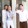 Couple visiting house for sale — Stock Photo