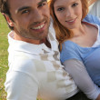 Young couple sitting on the lawn — Stock Photo