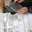 Architect sat with blueprints and calculator — Stock Photo