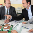 Stock Photo: Architects in meeting