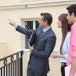 Couple and realtor showing property — Stock Photo