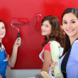 Girls painting wall — Stock Photo #10393458