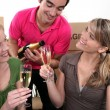 House-mates celebrating move — Stock Photo #10393573