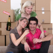 Young celebrating on moving day — Stock Photo #10393578