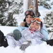Stock Photo: Couple laying down whilst on skiing trip
