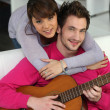 Stock Photo: Couple with guitar