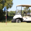 Stock Photo: Golf cart on course