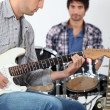 Young men playing music — Stock Photo
