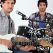 Stock Photo: Youth with guitar and drums