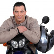 Man on a motorbike with his helmet on the side — Stock Photo