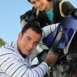 Stock Photo: Father and son with a motorbike