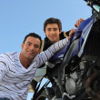 Father and son with motorcycle — Stock Photo #10394091