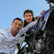 Stock Photo: Father and son with motorcycle