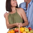 Couple with basket of fruits — Stock Photo