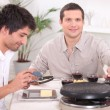 Two men enjoying Raclette — Stock Photo #10394236