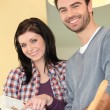 Young couple preparing healthy salad — Stock Photo #10394523