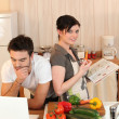 Stock Photo: Couple looking at recipes