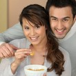 Couple eating from bowl — Stock Photo #10394538