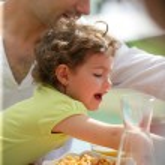 Family having breakfast in the garden — Stock Photo #10394549