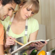 Couple following recipe - Stock Photo