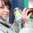 Stock Photo: Woman recycling glass bottles