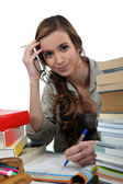 Female student studying hard — Stock Photo