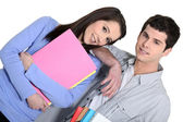 Cute brunette and male fellow student — Stock Photo