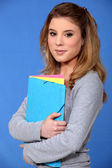 Student holding files — Stock Photo