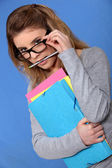 Woman putting on her glasses — Stock Photo