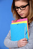 Young student carrying files — Stock Photo