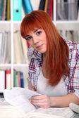 Redhead girl studying — Stock Photo