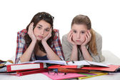 Young women sick of studying — Stock Photo